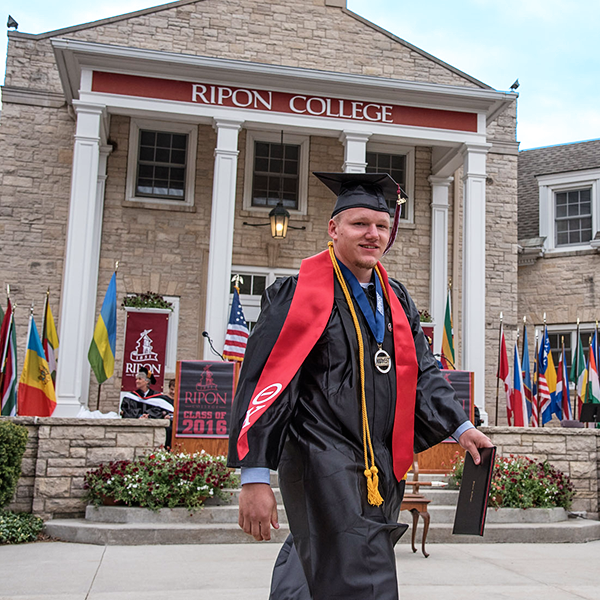 Graduate Frank Stelter-Hogh is all smiles after receiving his diploma.