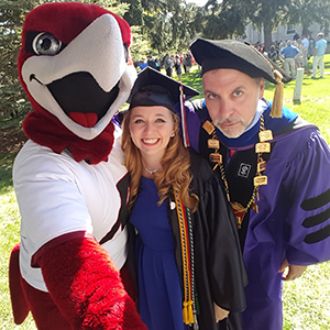 Rally and President Zach Messitte join Emily Cliff for a post-graduation selfie.
