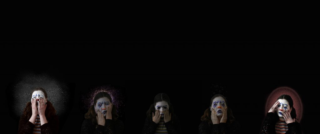 dark background with five clown figures