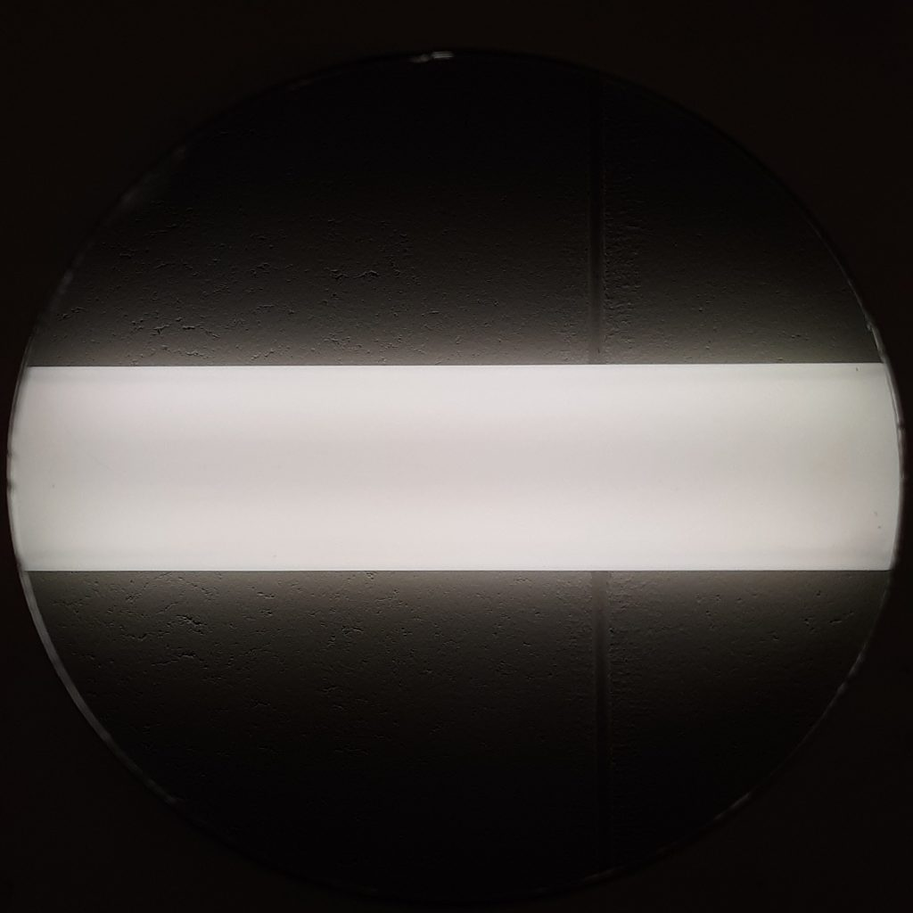 black background and white strip of light