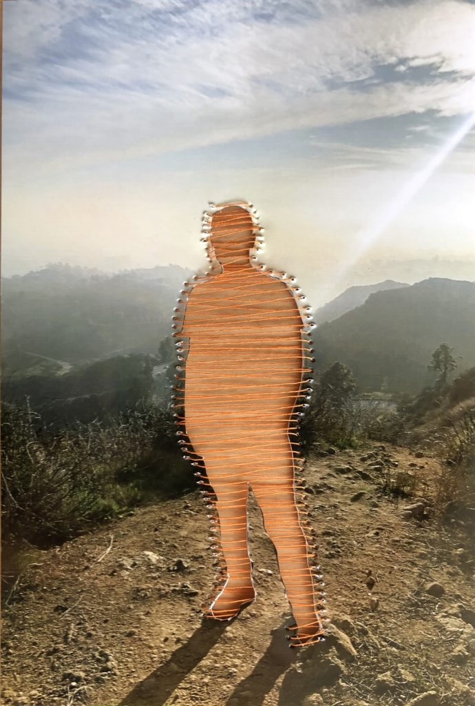 human outline in front of a sunset