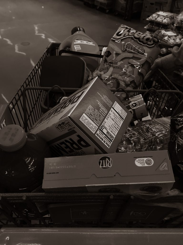 black and white photo of full shopping cart