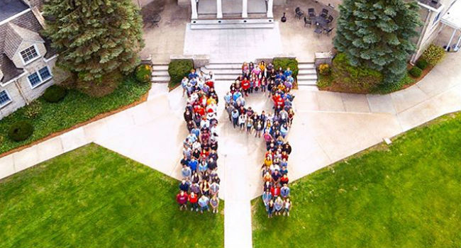 class of 2019 creating the number 19 in the lawn