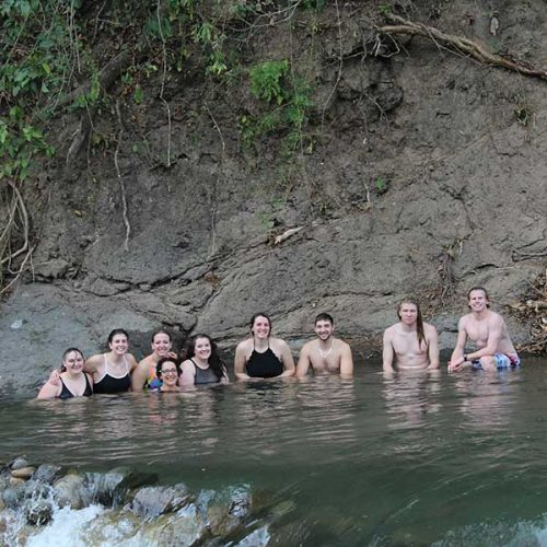 Photo of students in the 2018 Liberal Arts in Focus Costa Rica course bathing in the waters of Rio Gaucimal