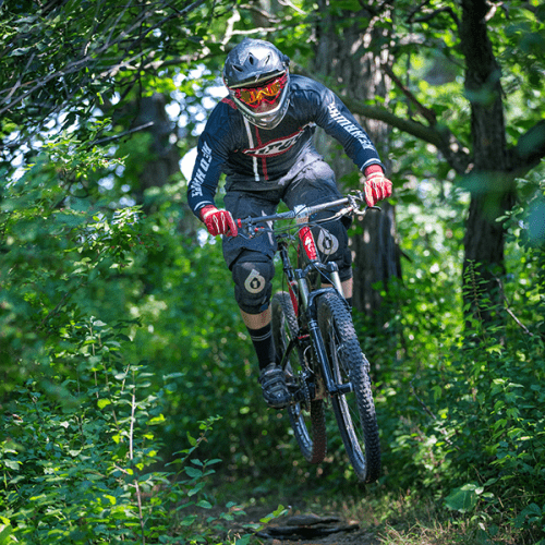 Alumnus Kyle Greene as a student on the cycling team riding the Ceresco Prairie mountain bike trail
