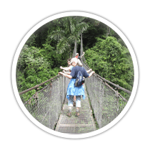 students crossing a bridge in the jungle