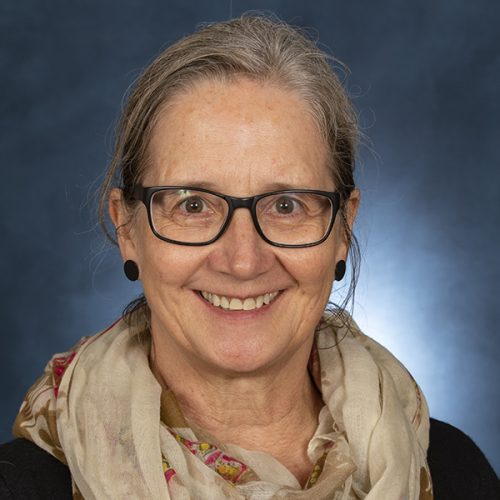 female professor, Sarah, with glasses and scarf