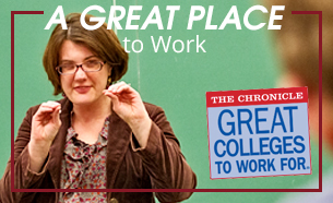professor in classroom with a label that says great place to work for
