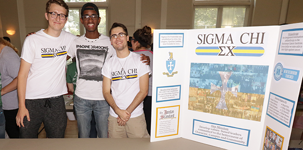 Members of Sigma Chi fraternity host a table at the recent student activities fair.