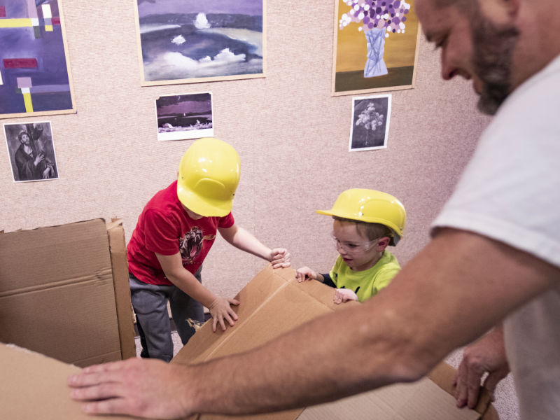 Local children have a blast with one of the student exhibits on display.