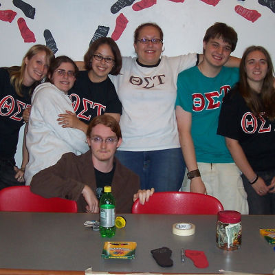 The siblings of Theta Sigma Tau pose together