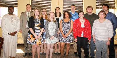 Students and staff after the Phi Sigma Iota (Foreign Language) honors society induction ceremony.