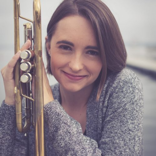Jessica Jensen posing with her trumpet