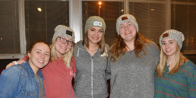 Students wearing Love Your Melon hats