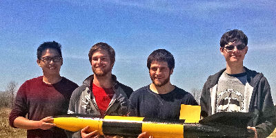 Physics students hold a rocket