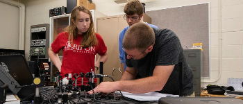 Students work directly in the Physics lab with the latest and greatest in technology