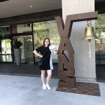 Zoe Hazel '22 in front of Vans headquarters
