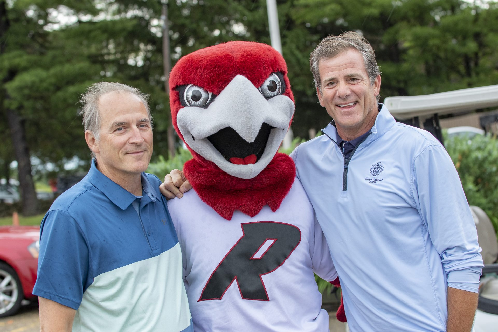 two men with red hawk mascot