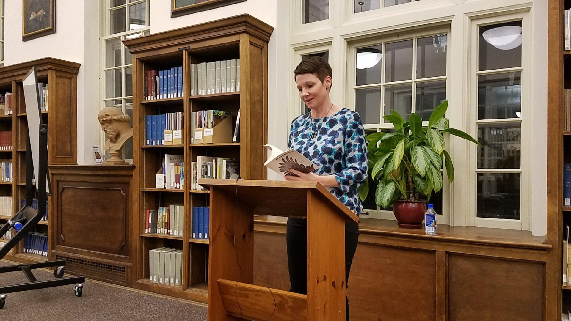 woman behind podium