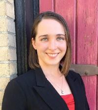 woman named sarah standing in front of red door
