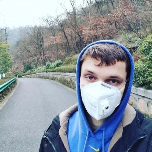 Daniel Mikesell '14 wearing a mask in a Nanjing, China, park