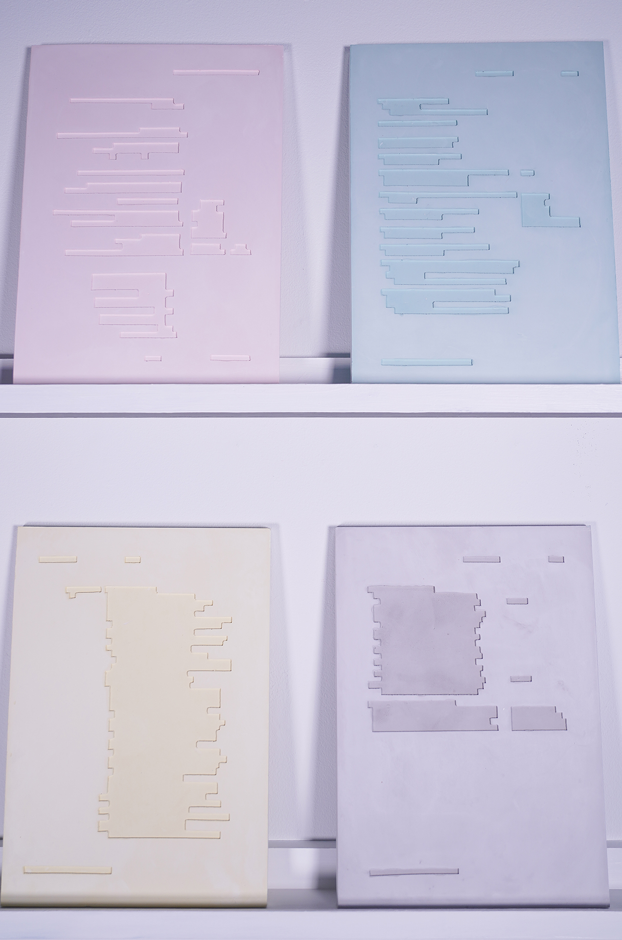 plaster pastel colored panels with etchings