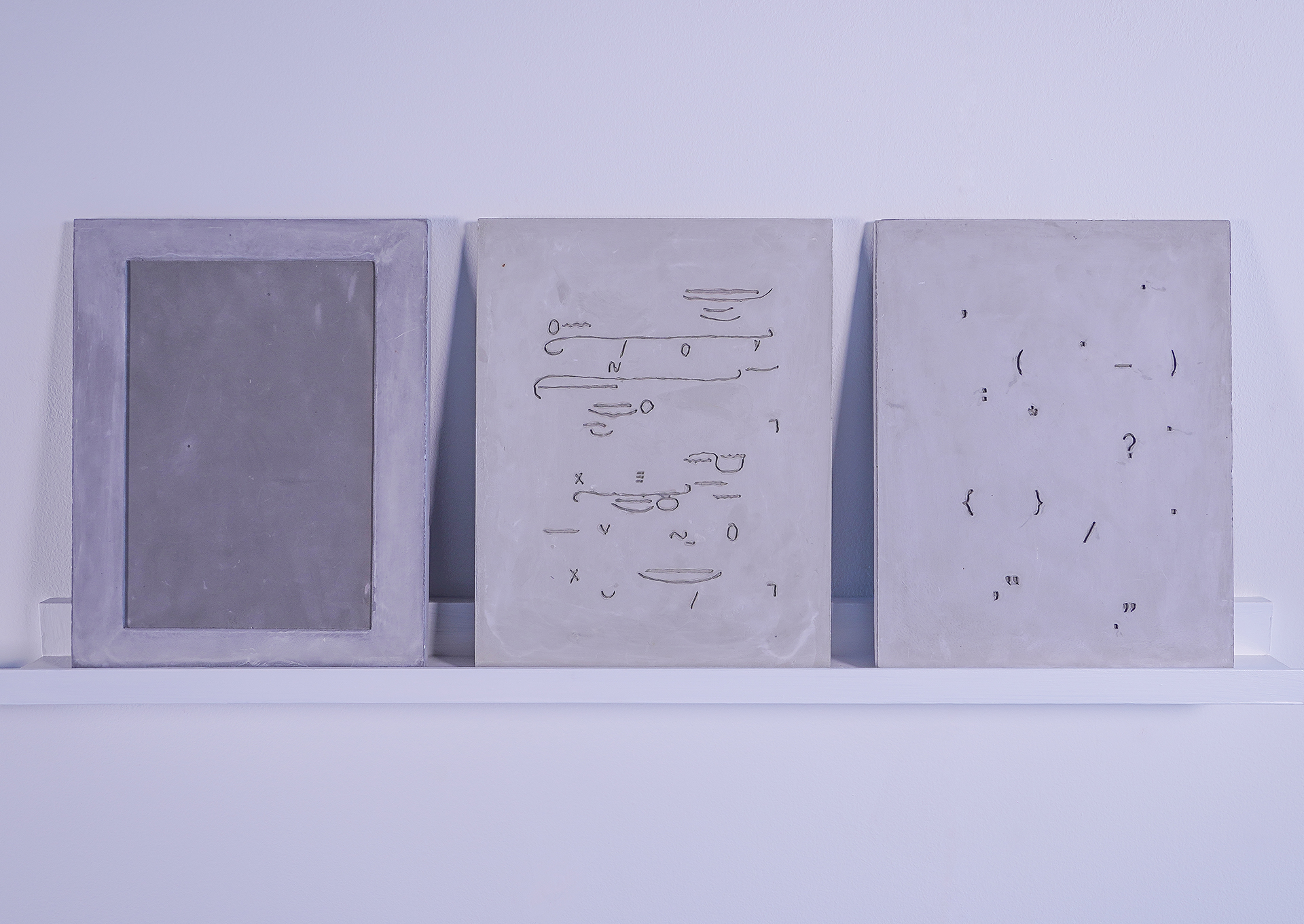 panels of gray art with etchings