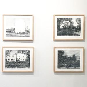 framed photos on a white wall