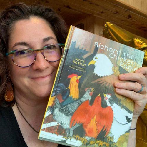 Carissa Rivara Sorensen '03 holding her book